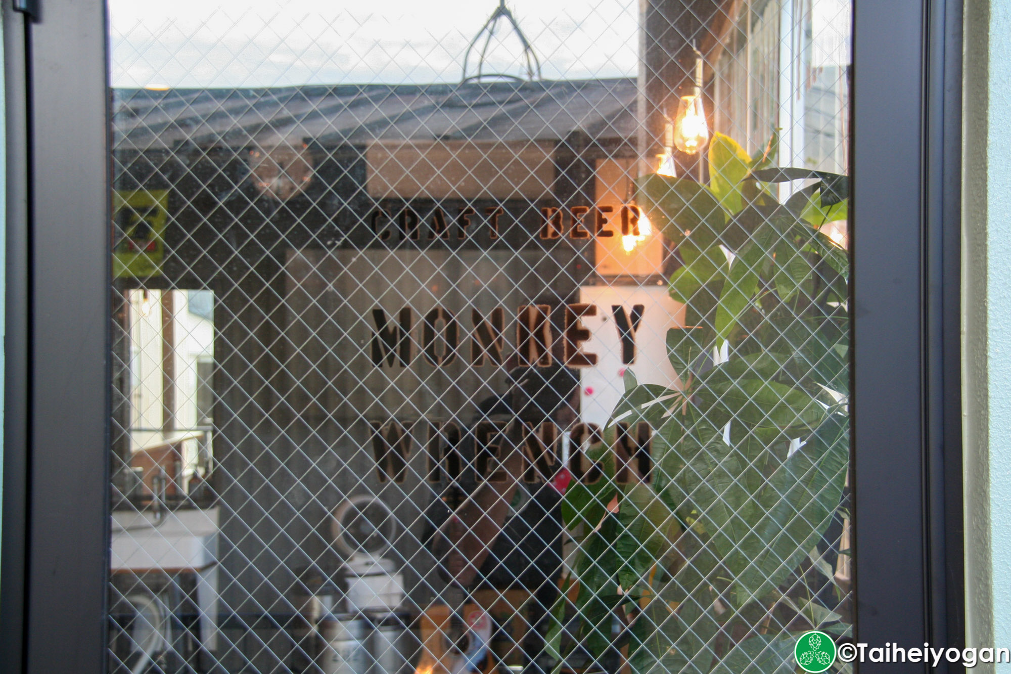 Monkey Wrench - Entrance - Sign